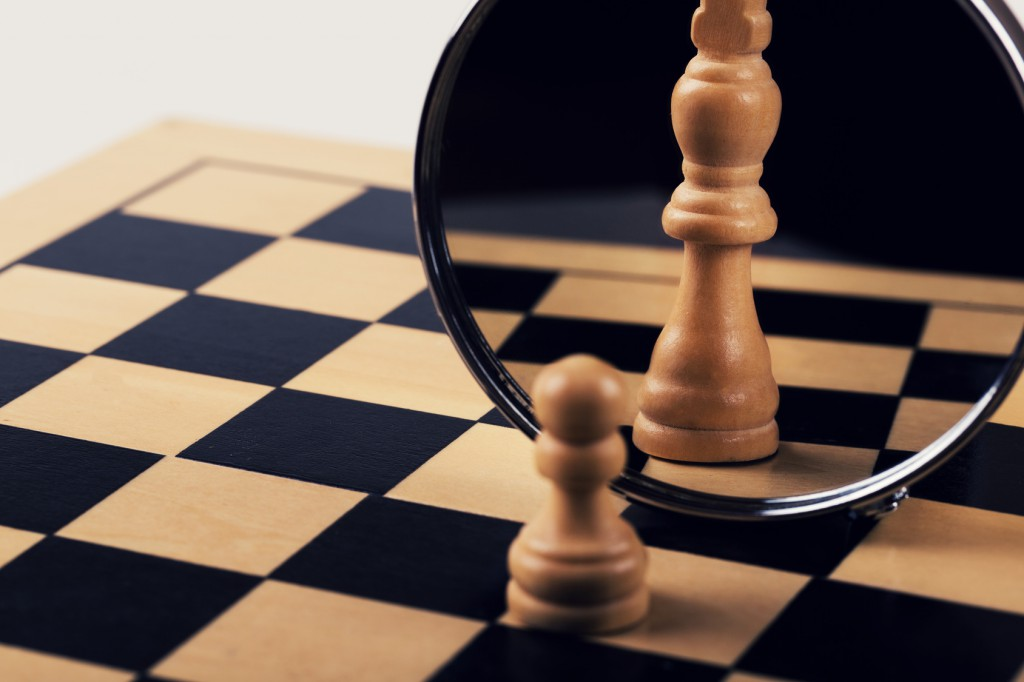 leadership, confidence and imagination concept - reflection in mirror